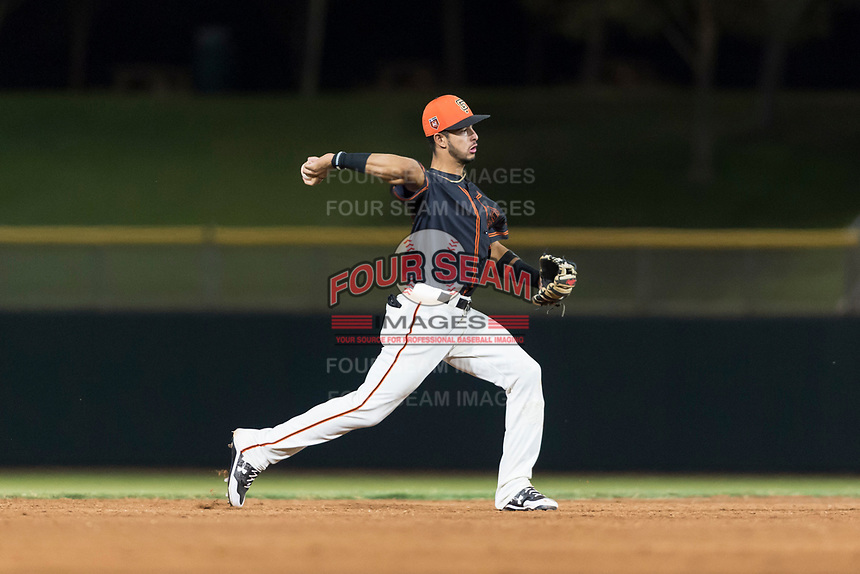 AZL Giants Black shortstop Enoc Watts (83) throws to first base during an Arizona League game against the AZL Rangers at Scottsdale Stadium on August 4, 2018 in Scottsdale, Arizona. The AZL Giants Black defeated the AZL Rangers by a score of 6-3 in the second game of a doubleheader. (Zachary Lucy/Four Seam Images)