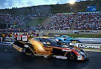 Jul. 19, 2013; Morrison, CO, USA: NHRA funny car driver Tony Pedregon (near) races alongside Jeff Diehl during qualifying for the Mile High Nationals at Bandimere Speedway. Mandatory Credit: Mark J. Rebilas-