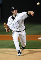 Starting pitcher Adam Westmoreland (25) of the South Carolina Gamecocks pitches in the first inning of a game against the Clemson Tigers on Tuesday, March 8, 2011, at Fluor Field in Greenville, S.C.  Photo by Tom Priddy / Four Seam Images