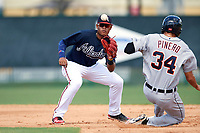 Atlanta Braves shortstop Kevin Maitan (50) waits for a throw as Danny Pinero (34) slides safely into second base after a pickoff attempt during an Instructional League game against the Detroit Tigers on October 10, 2017 at the ESPN Wide World of Sports Complex in Orlando, Florida.  (Mike Janes/Four Seam Images)
