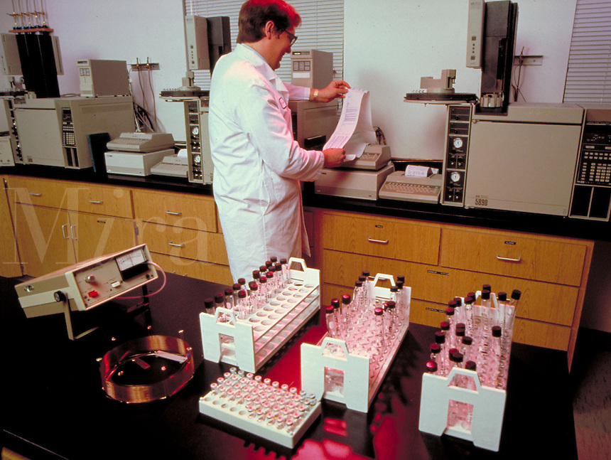 Laboratory testing for environmental pollutants. Pollution. Environment. occupations, protective clothing, biology, chemicals, ecology, man, men, lab, equipment, chemistry.