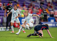 ORLANDO, FL - FEBRUARY 24: Aldana Cometti #6 of Argentina collides with Rose Lavelle #16 of the USWNT during a game between Argentina and USWNT at Exploria Stadium on February 24, 2021 in Orlando, Florida.
