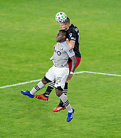 WASHINGTON, DC - NOVEMBER 8: Frederic Brillant #13 of D.C. United goes up for a header with Zachary Brault-Guillard #15 of the Montreal Impact during a game between Montreal Impact and D.C. United at Audi Field on November 8, 2020 in Washington, DC.