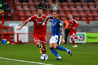 Jack Powell of Crawley Town and Lewis Alessandra of Carlisle United during Crawley Town vs Carlisle United, Sky Bet EFL League 2 Football at Broadfield Stadium on 21st November 2020