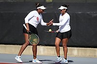 RALEIGH, NC - JANUARY 25: Sisters Ivana Corley and Carmen Corley of the University of Oklahoma during doubles during a game between Oklahoma and Florida at J.W. Isenhour Tennis Center on January 25, 2020 in Raleigh, North Carolina.