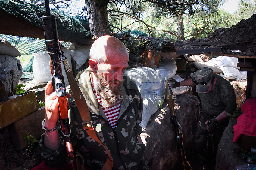 Russian-backed rebels guard their position near Marinka in the suburbs of Donetsk, eastern Ukraine, Monday, June 8, 2015.