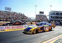 Sept. 25, 2011; Ennis, TX, USA: NHRA funny car driver Ron Capps (near lane) racing alongside brother Jon Capps during the Fall Nationals at the Texas Motorplex. Mandatory Credit: Mark J. Rebilas-