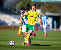 12th September 2020 The John Smiths Stadium, Huddersfield, Yorkshire, England; English Championship Football, Huddersfield Town versus Norwich City; Christoph Zimmermann (C) of Norwich City tracked by Josh Koroma of Huddersfield Town
