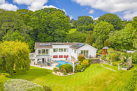 BNPS.co.uk (01202) 558833. <br /> Pic: LillicrapChilcott/BNPS<br /> <br /> Pictured: The garden.<br /> <br /> This impressive waterfront home with breath-taking views is the perfect property for a wannabe sailor - on the market for £2.5m.<br /> <br /> Huefield sits in an elevated position looking over the rooftops of neighbouring properties onto the beautiful Helford River in Cornwall - ideal for watching boats coming and going.<br /> <br /> The Helford Passage area is so sought after houses rarely come up for sale and this one, on the market with Lillicrap Chilcott, is the only property available there at the moment.<br /> <br /> The five-bedroom home is south facing and has a swimming pool and beautiful gardens for enjoying the view, as well as access to a gate with a right of way down to the water.