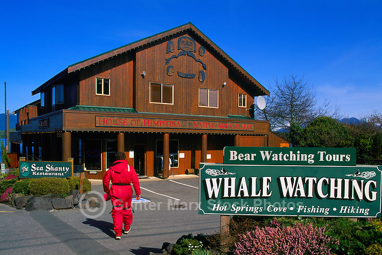 "Tofino, BC, Vancouver Island, British Columbia, Canada - Whale Watching Tourist at ""House of Himwitsa"", a First Nations Native Art Gallery"