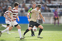 Houston, TX -  Sunday, December 11, 2016: Ian Harkes (16) of the Wake Forest Demon Deacons gains control of a loose ball in the first half against the Stanford Cardinal at the  NCAA Men's Soccer Finals at BBVA Compass Stadium.
