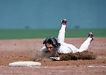 PHILADELPHIA:  Pete Rose of the Philadelphia Phillies dives head first into third base  during a pre-season game. Pete Rose played for the Philadelphia Philliess from 1979-1983. (Photo by Rich Pilling)