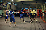 INDIA (West Bengal - Calcutta)August 2007,Shakila Babe and Shanno Babe at practice in Sports Authority of India Complex (East Zone) in Kolkata. Shakila and Shanno are twins from a poor muslim family of Iqbalpur, Kolkata. . Inspite of their late father's unwillingness to send his daughters to take up  boxing her mother Banno Begum inspired them to take up boxing at the age of 3. Their father was more concerned about the social stigma they have in their community regarding women coming into sports or doing anything which may show disrespect to the religious emotions of his community. Shakila now has been recognised as one of the best young woman boxers of the country after she won the  international championship at Turkey in the junior category. Shanno is also been called for the National camp this year. Presently Shakila and shanno has become the role model in the Iqbalpur area  and parents from muslim community of Iqbalpur have started showing interst in boxing. Iqbalpur is a poor muslim dominated area mostly covered with shanty town with all odds which comes along with poverty and lack of education. - Arindam Mukherjee