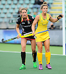 The Hague, Netherlands, June 05: Kellie White #16 of Australia reacts to a play during the field hockey group match (Women - Group A) between Belgium and Australia on June 5, 2014 during the World Cup 2014 at Kyocera Stadium in The Hague, Netherlands. Final score 2:3 (1:1) (Photo by Dirk Markgraf / www.265-images.com) *** Local caption *** Kellie White #16 of Australia, Aline Fobe #4 of Belgium