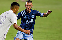 CARSON, CA - OCTOBER 18: Russell Teibert #31 of the Vancouver Whitecaps defending during a game between Vancouver Whitecaps and Los Angeles Galaxy at Dignity Heath Sports Park on October 18, 2020 in Carson, California.