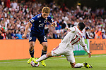 Doan Ritsu of Japan (L) fights for the ball with Vahid Amiri of Iran (R) during the AFC Asian Cup UAE 2019 Semi Finals match between I.R. Iran (IRN) and Japan (JPN) at Hazza Bin Zayed Stadium  on 28 January 2019 in Al Alin, United Arab Emirates. Photo by Marcio Rodrigo Machado / Power Sport Images