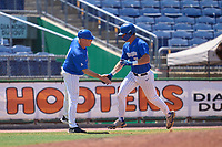 Memphis Tigers coach congratulates Taylor Howell (27) as he rounds the bases after hitting a home run during a game against the East Carolina Pirates on May 25, 2021 at BayCare Ballpark in Clearwater, Florida.  (Mike Janes/Four Seam Images)