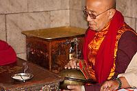 Bodhnath, Nepal.   Buddhist Monk Playing Cymbals at the Buddhist Stupa of Bodhnath.