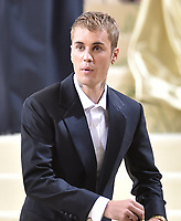 """NEW YORK, NEW YORK - SEPTEMBER 13: Justin Bieber at the 2021 Met Gala benefit """"In America: A Lexicon of Fashion"""" at Metropolitan Museum of Art on September 13, 2021 in New York City. Credit: John Palmer/MediaPunch"""