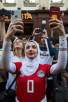 Moscow, Russia, 16/06/2018.<br /> A female Egypt supporter films fellow fans in central Moscow during the 2018 FIFA World Cup.
