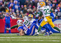 14 December 2014: Buffalo Bills tight end Scott Chandler is tackled by Green Bay Packers free safety Ha Ha Clinton-Dix after taking a short pass for a 12-yard gain in the fourth quarter at Ralph Wilson Stadium in Orchard Park, NY. The Bills defeated the Packers 21-13, snapping the Packers' 5-game winning streak and keeping the Bills' 2014 playoff hopes alive. Mandatory Credit: Ed Wolfstein Photo *** RAW (NEF) Image File Available ***