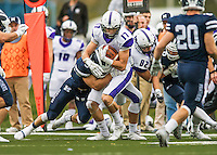 8 October 2016: Amherst College Purple & White Wide Receiver Nick Widen, a Senior from Weston, MA, is tackled by Middlebury College Panther Linebacker Wesley Becton, a Junior from Elmhurst, IL at Alumni Stadium in Middlebury, Vermont. The Panthers edged out the Purple & While 27-26. Mandatory Credit: Ed Wolfstein Photo *** RAW (NEF) Image File Available ***