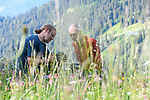 Teaching flower / macro photography in an Alpine flower meadow. Tirol, Alps, Austria.