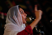 Punjab, Pakistan<br /> November 12, 1988<br /> <br /> Benazir Bhutto campaigns in the Punjab Province.<br /> <br /> Benazir Bhutto is the eldest child of former Pakistan President and Prime Minister Zulfikar Ali Bhutto. She found herself placed under house arrest in the wake of her father's imprisonment and subsequent execution in 1979. In 1984 she became the leader in exile of the Pakistan Peoples Party (PPP), her father's party, though she was unable to make her political presence felt in Pakistan until after the death of General Muhammad Zia-ul-Haq. <br /> <br /> On 16 November 1988 Benazir's PPP won the largest bloc of seats in the National Assembly. Bhutto was sworn in as Prime Minister in December, at age 35 she became the first woman to head the government of a Muslim-majority state in modern times. <br /> <br /> She was removed from office 20 months later under orders of then-president Ghulam Ishaq Khan for alleged corruption. Bhutto was re-elected in 1993 but was again removed by President Farooq Leghari in 1996, on similar charges. Bhutto went into self-imposed exile in Dubai in 1998, until she returned to Pakistan on October 2007, after General Musharraf granted her amnesty and all corruption charges withdrawn.