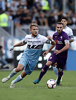 Football, Serie A: S.S. Lazio - Fiorentina, Olympic stadium, Rome, 7 ottobre 2018. <br /> Lazio's Ciro immobile (l) in action Fiorentina's captain German Pezzella (r) during the Italian Serie A football match between S.S. Lazio and Fiorentina at Rome's Olympic stadium, Rome on October 7, 2018.<br /> UPDATE IMAGES PRESS/Isabella Bonotto