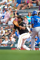 Pittsburgh Pirates first baseman Josh Bell (55) stretches for a throw as Anthony Alford (75) runs through the bag during a Spring Training game against the Toronto Blue Jays  on March 3, 2016 at McKechnie Field in Bradenton, Florida.  Toronto defeated Pittsburgh 10-8.  (Mike Janes/Four Seam Images)