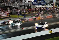 Jun. 17, 2011; Bristol, TN, USA: NHRA funny car driver Melanie Troxel (right) alongside John Force during qualifying for the Thunder Valley Nationals at Bristol Dragway. Mandatory Credit: Mark J. Rebilas-