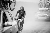rider trying to see what's ahead as cars create dust-storms to ride through<br /> <br /> 90th Schaal Sels 2015