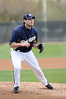 Tim Dillard #48 of the Milwaukee Brewers participates in pitchers fielding practice during spring training workouts at the Brewers complex on February 18, 2011  in Phoenix, Arizona. .Photo by Bill Mitchell / Four Seam Images.