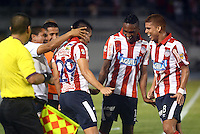 BARRANQUILLA  -COLOMBIA, 25-MARZO-2015. Jorge Aguirre jugador del Atletico Junior celebra su gol con sus companeros  contra  Patriotas de Boyaca durante partido por la fecha 1 de la Liga  çguila I 2015 jugado en el estadio Metropolitano  de la ciudad de Barranquilla./ Jorge Aguirre player of Atletico Junior  celebrates his goal  against of Patriotas during the match for the first date of the Liga  Aguila I 2015 played at Metropolitano  stadium in Barranquilla city<br />  . Photo / VizzorImage / Alfonso Cervantes / Stringer