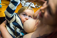 A mother breastfeeds her two year old daughter in the family restaurant and play area of a pub.<br /> <br /> Lancashire, England, UK<br /> <br /> Date Taken:<br /> 07-01-2015<br /> <br /> © Paul Carter / wdiip.co.uk