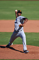 Surprise Saguaros pitcher Domingo Acevedo (21) delivers a pitch during an Arizona Fall League game against the Scottsdale Scorpions on October 22, 2015 at Scottsdale Stadium in Scottsdale, Arizona.  Surprise defeated Scottsdale 7-6.  (Mike Janes/Four Seam Images)