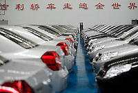 "Workers at the Geely Automobiles Factory in Taizhou, Zhejiang Province, China. The characters on the wall says: ""Geely sedans walk all over the world"". Geely's profit rose 88 percent in 2006 as it sold more mid-range cars.."