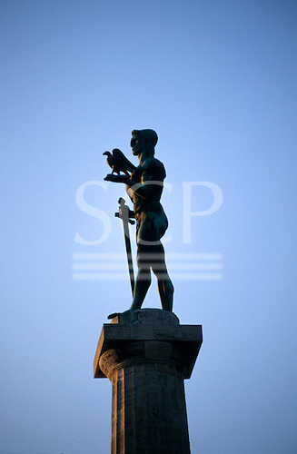 Belgrade, Serbia, Yugoslavia. Winner statue (Pobednik) by Ivan Mestrovic, holding a dove and lowered sword. Kalemegdan citadel.