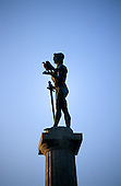 Belgrade, Serbia, Yugoslavia. Winner statue (Pobednik) by Ivan Mestrovic, holding a dove and lowered sword. Kalemegdan citadel.