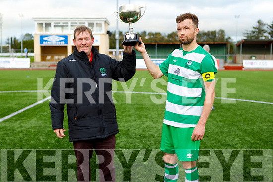Killarney Celtic captain Gary Keane accepts the Greyhound Bar Cup from Sean O'Keefe, Chairman KDL having beaten Killarney Athletic in the final.