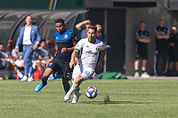 Portland, Oregon - Sunday October 6, 2019: Sebastian Blanco #10 dribbles the ball while being chased by Marcos Lopez #27 during a regular season match between Portland Timbers and San Jose Earthquakes at Providence Park in Portland, Oregon.
