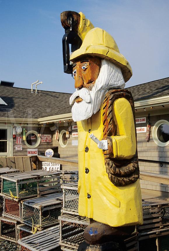 Salisbury, Massachusetts.Fisherman sculpture at a seafood restaurant is typical folk art