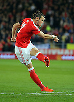 Gareth Bale of Wales scores his opening goal during the 2018 FIFA World Cup Qualifier between Wales and Serbia at the Cardiff City Stadium, Wales, UK. Saturday 12 November 2016