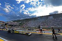 Jul, 20, 2012; Morrison, CO, USA: NHRA crew members for top fuel dragster driver Morgan Lucas (near lane) alongside Doug Kalitta during qualifying for the Mile High Nationals at Bandimere Speedway. Mandatory Credit: Mark J. Rebilas-