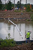 Boom placed across Alum Creek below Main Street Bridge construction