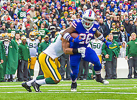 """14 December 2014: Buffalo Bills running back Anthony """"Boobie"""" Dixon rushes for a 5-yard gain in the second quarter against the Green Bay Packers at Ralph Wilson Stadium in Orchard Park, NY. The Bills defeated the Packers 21-13, snapping the Packers' 5-game winning streak and keeping the Bills' 2014 playoff hopes alive. Mandatory Credit: Ed Wolfstein Photo *** RAW (NEF) Image File Available ***"""