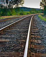 Looking down the railway tracks towards a curve in Milton Ontario near the Niagara Escarpment.