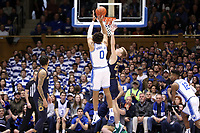 DUKE, NC - FEBRUARY 15: Wendell Moore Jr. #0 of Duke University shoots over Dane Goodwin #23 of the University of Notre Dame during a game between Notre Dame and Duke at Cameron Indoor Stadium on February 15, 2020 in Duke, North Carolina.