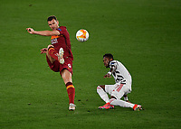 Football: Uefa Europa League - semifinal 2nd leg AS Roma vs Manchester United Olympic Stadium. Rome, Italy, May 6, 2021.<br /> Roma's Edin Dzeko (L) in action with Manchester United's Fred  (R) during the Europa League football match between Roma and Manchester United at Rome's Olympic stadium, Rome, on May 6, 2021.  <br /> UPDATE IMAGES PRESS/Isabella Bonotto