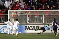 SMU goalkeeper Matt Wideman (right) guesses wrong and Maryland's Stephen King (7) slots home a 50th minute penalty kick, making the score 4-0. The University of Maryland defeated Southern Methodist University 4-1 in the NCAA Semifinal at SAS Stadium in Cary, North Carolina, Friday, December 9, 2005.